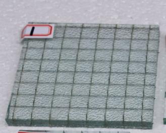 夹丝玻璃中的金属丝网网格形状一般为方形或者六角形,而玻璃表面可以