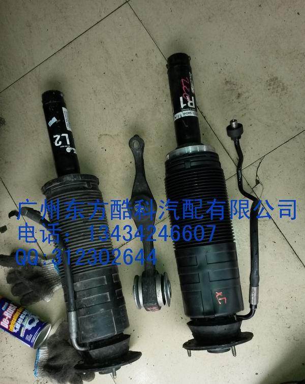 气压减震器,如果是老款的就是弹簧型的减震器图片